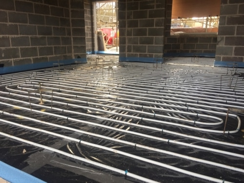 An underfloor heating system under construction